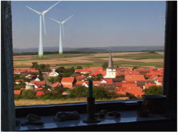 wind turbines next to a European village